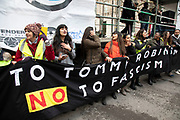 Demonstrators gather for the 'Oppose Tommy Robinson, unite against racism & fascism' counter demonstration organised for anti-fascist groups opposed to far right politics, regardless of their positions on leave/remain on Brexit on 9th December 2018 in London, United Kingdom.