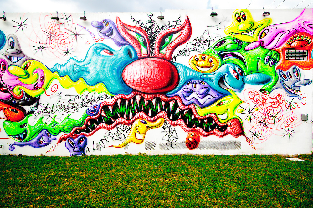 Mural by pop artist Kenny Scharf at The Wynwood Walls outdoor street art museum in Miami. Scharf later modified this mural by painting in most of the white spaces.