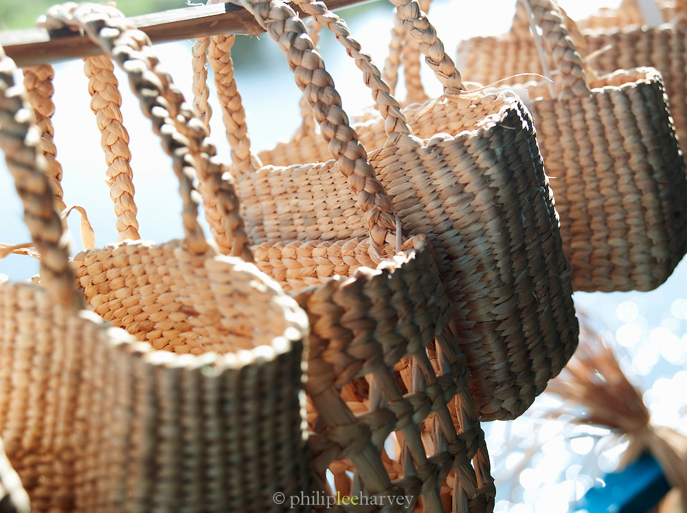 Baskets for sale from a community project by the residents of the floating villagev Kompong Phluk on the great Tonlé Sap lake, Cambodia
