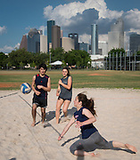 Students play beach volleyball outside Carnegie Vanguard High School, April 22, 2018.