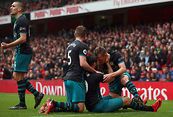 Southampton's Charlie Austin (centre) celebrates scoring his side's second goal of the game during the Premier League match at the Emirates Stadium, London.