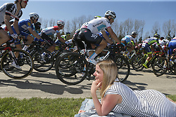 April 18, 2018 - Huy, Belgique - A woman laying on a blanket watching the pentalon go by during the 82th edition of the UCI World Tour Ardennes Classics cycling race Fleche Wallonne with start in Seraing and finish in Huy on April 18, 2018 in Huy, Belgium. (Credit Image: © Panoramic via ZUMA Press)