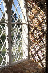 Window in the shell house at Ballymaloe designed by Blott Kerr-Wilson