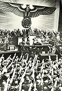 Adolf Hitler addressing a meeting in the Reichstag circa 1935.