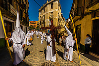 Hooded penitents called nazarenos from the Brotherhood (Hermandad) de Nuestro Padre Jesus on in a procession on Palm Sunday of Holy Week (Semana Santa), Loja, Granada Province, Andalusia, Spain.