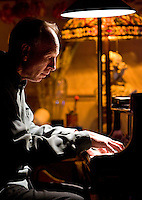 "Torrington, Conn. - March 14, 2009 - Tim Wallace plays his piano during a performance of ""Music of the Moment: Winds of Change,"" an event of improvised music with singer Andrea Loretz-Frey and clarinet/saxophone player Todd Brunel on Saturday, March 14 at Wallace's home and studio in Torrington. Wallace is a member of the Torrington arts commission..Josalee Thrift Photo"