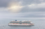 """Britain's largest and most environmentally-friendly cruise ship, P&O Cruises Iona, heads towards the south coast as she makes her way towards her home port of Southampton this morning ahead of tonight's official naming ceremony.<br /> <br /> Iona is powered by liquefied natural gas, ground-breaking for the UK cruise industry and one of the cleanest fuels in the world.<br /> <br /> The ship will be named this evening in a glittering quayside ceremony hosted by Jo Whiley and broadcast to a """"virtual"""" audience, the highlight of which will be a performance by Iona's music director Gary Barlow.<br /> <br /> Dame Irene Hays, chair of Hays Travel, Britain's largest independent travel agency, will name the ship and a specially produced Nebuchadnezzar (equivalent to 20x 750ml bottles) of Alex James's Britpop cider will smash against the hull of the ship to bring it good fortune in the future.  <br /> <br /> Iona will have 30 bars and restaurants with many new speciality dining options including tapas from award-winning Spanish chef José Pizarro paired with wines selected by Olly Smith. Entertainment venues include the first """"SkyDome"""" - an extraordinary glass structure which will be a relaxed poolside environment by day and then transform at night into a spectacular venue with DJs, stage and aerial acrobatic shows.<br /> <br /> There will also be the first gin still on a cruise ship, created in association with Salcombe Gin, distilling tailor made spirit on board. The gin's maiden production will take place in Iona's custom-made still named """"Columba"""" and will be distilled, bottled and labelled on board. <br /> <br />  <br /> Picture date Sunday 16th May, 2021.<br /> Picture by Christopher Ison. Contact +447544 044177 chris@christopherison.com<br /> <br /> For further press information please contact: <br /> Michele Andjel, michele.andjel@carnivalukgroup.com 023 8065 6653 / 07730 732 072<br /> Laura Tattam, laura.tattam@pocruises.com 02380 656651 / 07771 283 845<br /> Jenny Had"""