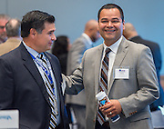 Rene Sanchez, left, and Steve Guerrero, right, during an East End Chamber of Commerce Education Symposium held at the Federal Reserve Bank, April 27, 2016.