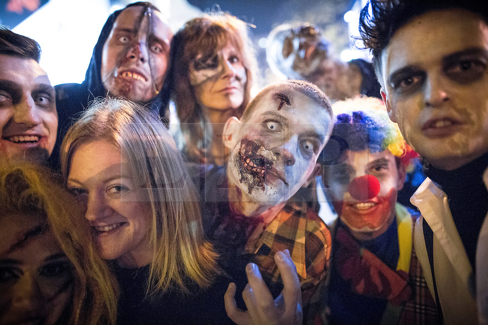 © Licensed to London News Pictures . 01/11/2015 . Manchester , UK . Halloween revellers , wearing make up and costumes , out and about in Manchester City Centre . Photo credit : Joel Goodman/LNP