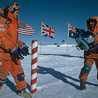 Expedition leaders Will Steger & Jean-Louis Etienne play at the ceremonial South Pole, halfway through the 1989-1990 Trans-Antarctica Expedition.