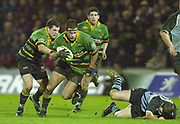 Photo Peter Spurrier<br /> 07/12/2002<br /> European Rugby - Heineken Cup Northamton vs Cardiff.<br /> Saints capt.  Budge Pountney supporteed by Paul Grayson left and Ian Vass set runs of the back of the scrum.