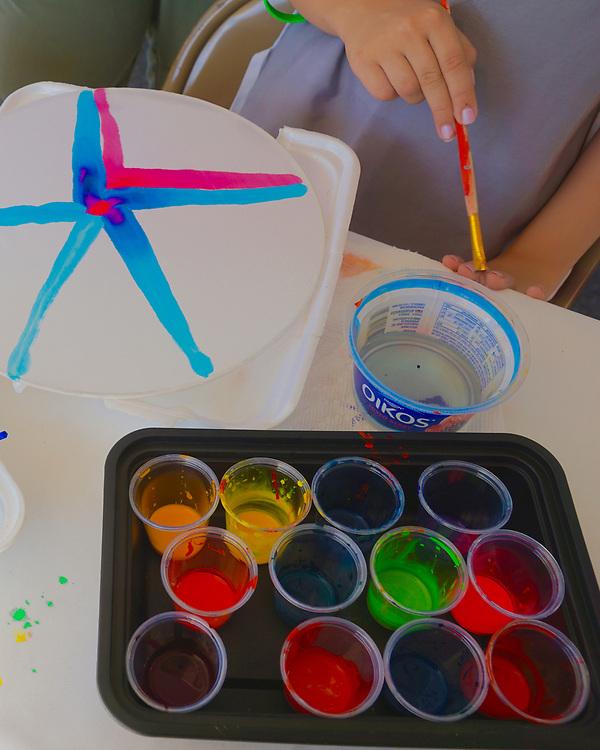 Child paints on silk sun catcher, West Reading Art Fest, Art Plus Gallery, Berks Co.,PA