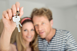 Couple presenting house keys new home