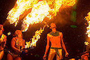 Tami Lane, Jen (Germany) Comer, and Chris (Sorn) Yung of Garnish, the Portland-based Fire Conclave breathe fire at the 2013 Burning Man festival.