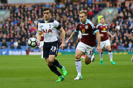 Harry Winks of Tottenham Hotspur is chased by Scott Arfield of Burnley (r). Premier League match, Burnley v Tottenham Hotspur at Turf Moor in Burnley , Lancs on Saturday 1st April 2017.<br /> pic by Chris Stading, Andrew Orchard sports photography.
