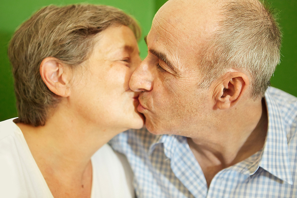 Lifestyle image of senior couple in love and kissing