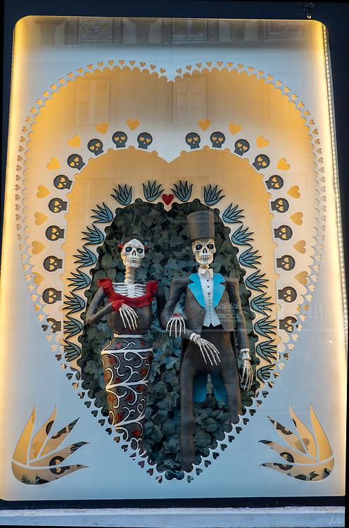 Seen inside a wedding shop window in Lisbon, Portugal,a couple of skeletons all dressed up to be married.