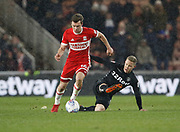 Jonathan Howson of Middlesbrough goes past Leeds United midfielder Adam Forshaw  during the EFL Sky Bet Championship match between Middlesbrough and Leeds United at the Riverside Stadium, Middlesbrough, England on 2 March 2018. Picture by Paul Thompson.