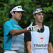 Bubba Watson, USA and his caddie Ted Scott, (right),  during the second round of the Travelers Championship at the TPC River Highlands, Cromwell, Connecticut, USA. 20th June 2014. Photo Tim Clayton