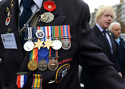 © Licensed to London News Pictures. 02/05/2012. London, UK London Mayor,Boris Johnson(right) is joined bycomedian Al Murrayto wave off an army ofWWII veterans who are embarking on an iconic trip to the Netherlands, via a convoy of black cabs.The London Taxi Benevolent Association for the War Disabled has organised a trip for 160 WWII veterans to travel to Holland in 80 London Black Cabs. The veterans, mostly aged between 85 and 94, will start their journey from London today 2nd May 2012 and will be visiting sites of importance from WWII and taking part in Dutch Liberation Day celebrations as guests of honour of the Dutch Royal Family.. Photo credit : Stephen Simpson/LNP