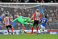 Idrissa Gueye of Everton shoots and scores his teams 1st goal as Sunderland goalkeeper Jordan Pickford dives in vain.  . Premier league match, Everton v Sunderland at Goodison Park in Liverpool, Merseyside on Saturday 25th February 2017.<br /> pic by Chris Stading, Andrew Orchard sports photography.