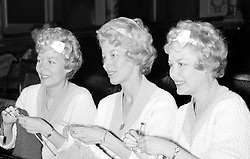 File photo dated 02/11/1958 of The Beverley Sisters (left to right) Babs, Joy and Teddie knitting in the stalls as they await their call to take part in a rehearsal of the Royal Variety Performance at the London Coliseum. Babs Beverley of the Beverley Sisters has died at the age of 91.