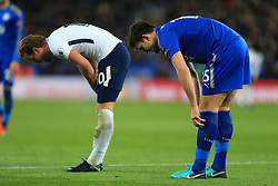28th November 2017 - Premier League - Leicester City v Tottenham Hotspur - Harry Maguire of Leicester and Harry Kane of Spurs pull their socks up - Photo: Simon Stacpoole / Offside.