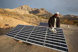 Iqbal with his new solar panel, which will provide power for lights and other appliances at home, which is part of the NCA   Solar Power project, Palaj Village, Shahrestan, Daikundi Province, Afghanistan.