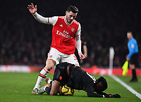 Football - 2019 / 2020 Premier League - Arsenal vs. Manchester United<br /> <br /> Arsenal's Sead Kolasinac battles for possession with Manchester United's Aaron Wan-Bissaka, at The Emirates Stadium.<br /> <br /> COLORSPORT/ASHLEY WESTERN