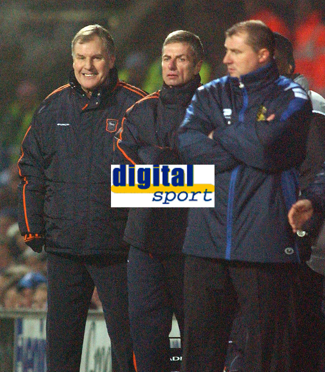 Photo: Daniel Hambury.<br /> The Coca Cola Championship.<br /> Ipswich Town V Wigan Athletic.   21/12/2004<br /> Ipswich's manager Joe Royal smiles as his side win with a goal in the last first minutes as Wigan's Paul Jewell looks on dissapointed
