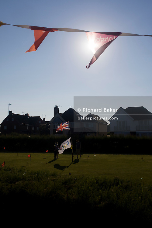 Olympic flags flying on a mini golf putting green in the Suffolk seaside town of Southwold, Suffolk.