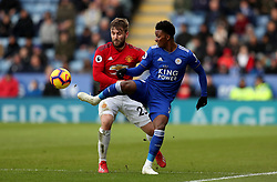 Manchester United's Luke Shaw in action with Leicester City's Demarai Gray