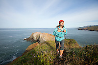 Young woman hiking in the Marin Headlands. Golden Gate National Recreation Area. San Francisco, CA
