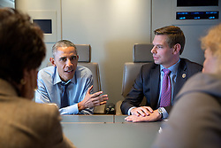 President Barack Obama meets with California Democratic Members of Congress, from left, Rep. Anna Eshoo, Rep. Eric Swalwell and Rep. Zoe Lofgren aboard Air Force One en route to San Francisco, Calif., Feb. 12, 2015. (Official White House Photo by Pete Souza)<br /> <br /> This official White House photograph is being made available only for publication by news organizations and/or for personal use printing by the subject(s) of the photograph. The photograph may not be manipulated in any way and may not be used in commercial or political materials, advertisements, emails, products, promotions that in any way suggests approval or endorsement of the President, the First Family, or the White House.