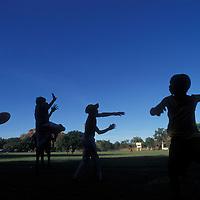 Australia, Western Australia, Aboriginal boys play Aussie Rules Football during half-time at tournament in Kununurra
