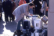 A reporter  types his story on a typewriter during President Carter's  visit to Saudi Arabia (Riyadh) to meet with King Khalid and Crown Prince Fahd.