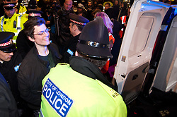 © licensed to London News Pictures. London, UK. 27/01/12. Protestor from inside building arrested. Protestors cleared from new site in the City of London. The 'Bank of Ideas' group, who had occupied the disused Bank of Iraq building at 7-10 Leadenhall, are cleared after it emerged the building is a diplomatic premises under Section 9 of the 1977 Criminal Law Act. Fire services cleared the street after finding a strong smell of Diesel upon entry to the premises and cleared. Photo credit: Jules Mattsson/LNP