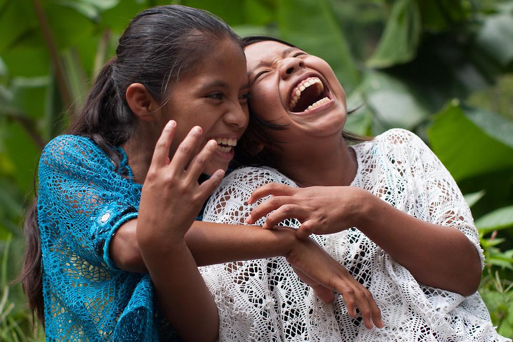 Q'eqchi girls laughing in Concepción Actelá, Alta Verapaz.