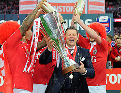 Bristol City manager, Steve Cotterill is covered in champagne as he lifts the JPT trophy  - Photo mandatory by-line: Joe Meredith/JMP - Mobile: 07966 386802 - 22/03/2015 - SPORT - Football - London - Wembley Stadium - Bristol City v Walsall - Johnstone Paint Trophy Final