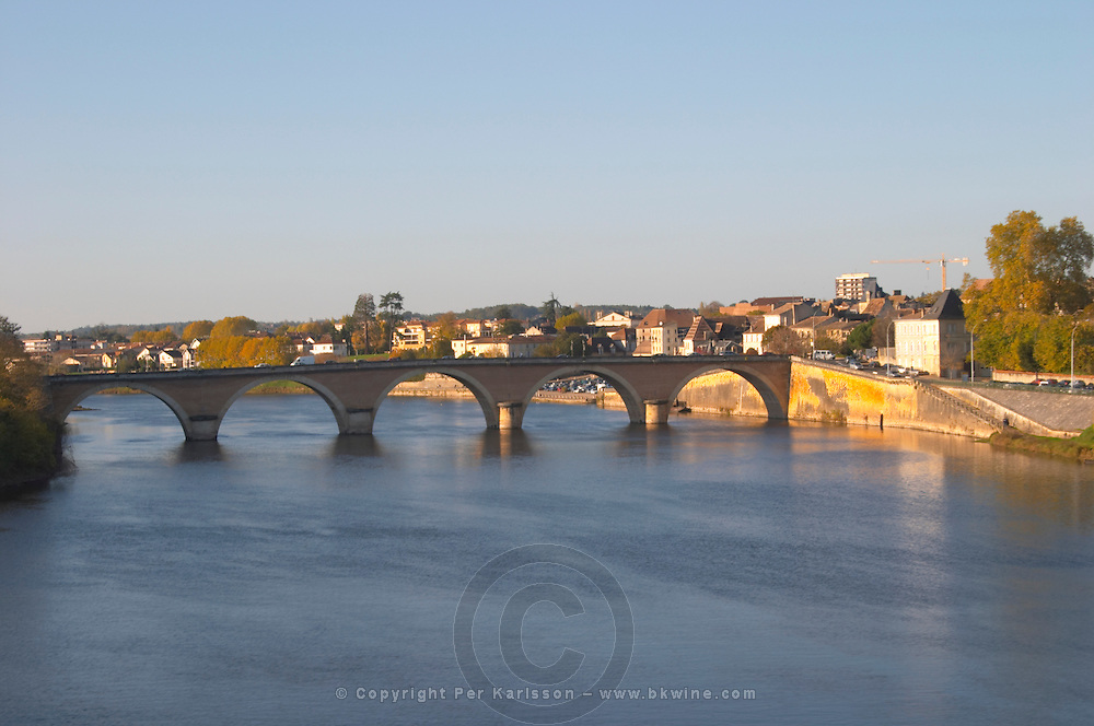 The bridge across the river Dordogne and the Old Town of Bergerac in morning sunshine. Bergerac Dordogne France