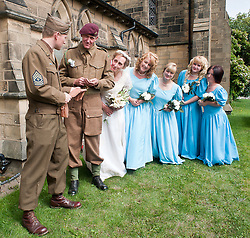 In hard times you have to pick up luxuries where you can a passing US serviceman offers up silk stockings to the groom at the 1940's Wedding of Reenactors Andy Hacking and Kath Hacking (nee Plummer) held at Saint John The Divine Church Lytham. Both members of the  Northern World War 2 Association Andy  and Kath chose to tie the knot surround by family and friends during the Lytham 1940's war weekend.19 August 2011  Image © Paul David Drabble