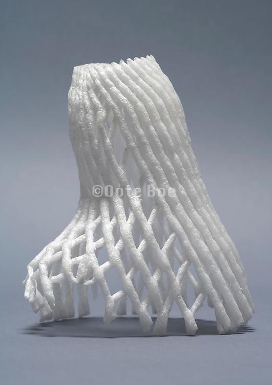 wine bottle transport protection net made of a foamy plastic