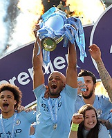 Football - 2018 / 2019 Premier League - Brighton & Hove Albion vs. Manchester City<br /> <br /> Vincent Kompany of Man City lifts the Premier League trophy, at The Amex.<br /> <br /> COLORSPORT/ANDREW COWIE