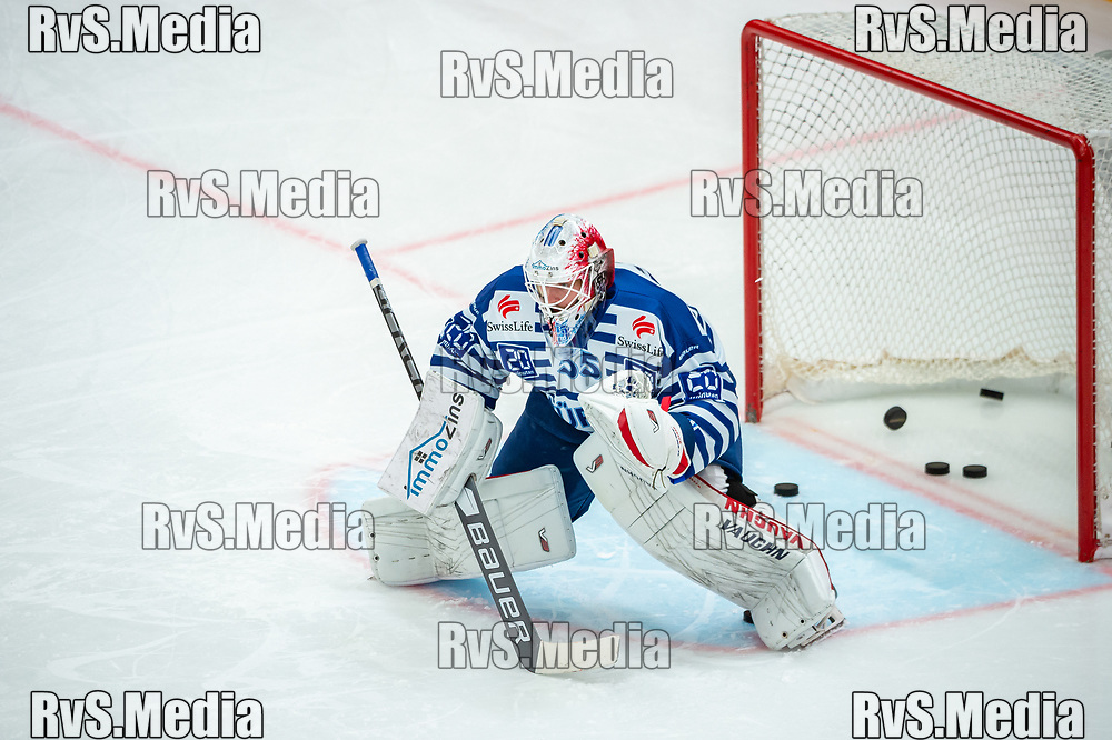 LAUSANNE, SWITZERLAND - OCTOBER 01: Goalie Ludovic Waeber #35 of ZSC Lions warms up prior the Swiss National League game between Lausanne HC and ZSC Lions at Vaudoise Arena on October 1, 2021 in Lausanne, Switzerland. (Photo by Robert Hradil/RvS.Media)