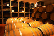 The barrel aging cellar with barriques and bottles. Bodega Bouza Winery, Canelones, Montevideo, Uruguay, South America