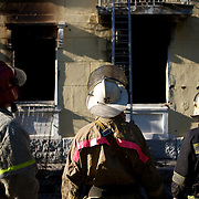 Firemen prepare to enter Mariupol's police headquarters, set ablaze hours earlier during deadly confrontations between armed separatist groups and the Ukrainian army over the control of key buildings throughout the city.