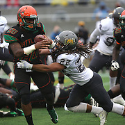 Florida A&M Rattlers running back Tysean Holloway (20) is tackled by Bethune Cookman  defender Joshua Richardson (22) during the Florida Classic NCAA football game between the FAMU Rattlers and the Bethune Cookman Wildcats at the Florida Citrus bowl on Saturday, November 22, 2014 in Orlando, Florida. (AP Photo/Alex Menendez)