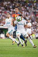 Real Madrid's Mateo Kovacic and Carlos Henrique Casemiro and Valencia's Rodrigo Moreno during La Liga match between Real Madrid and Valencia CF at Santiago Bernabeu Stadium in Madrid, Spain August 27, 2017. (ALTERPHOTOS/Borja B.Hojas)