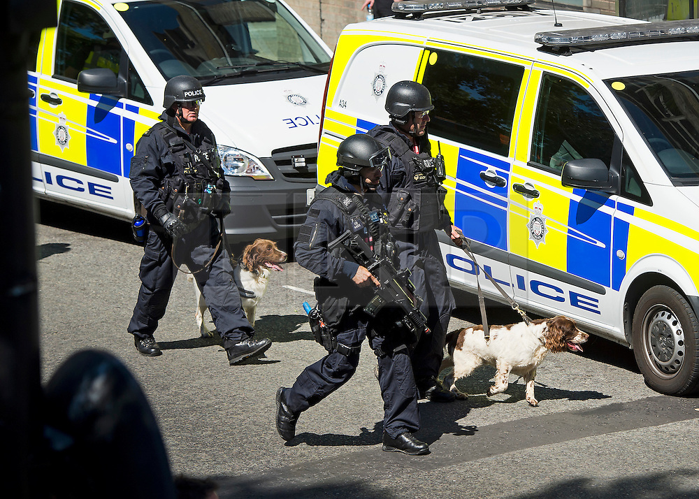 © Licensed to London News Pictures. 30/06/2015. London, UK. Armed police with dogs at the scene. Members of the emergency service take part in a mocked-up terrorist firearms attack at Aldwych station in central London. The exercise is the biggest to take place in London and is happening a week after dozens of people where killed when a gunman opened fire on a beach in Tunisia.  Photo credit: Ben Cawthra/LNP