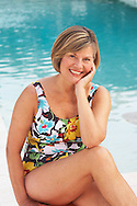 This photograph of an older lady relaxing at the pool in her swimsuit was digitally captured for H2O Swimwear.